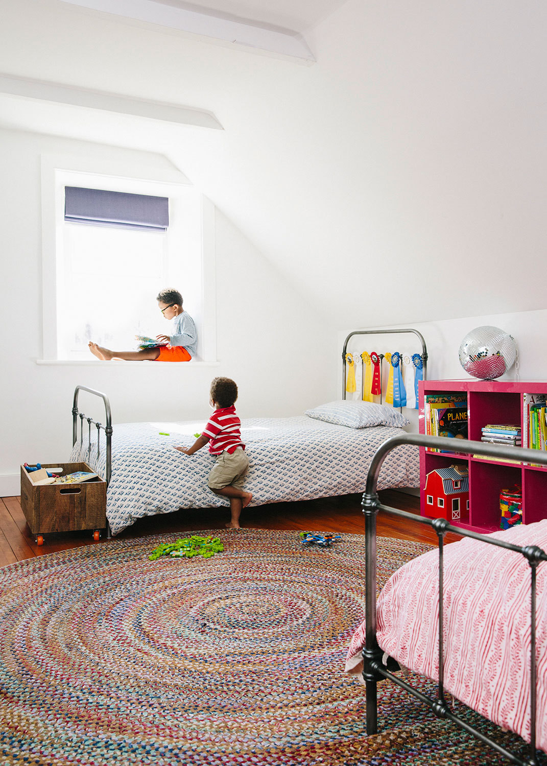 The Kidsu0027 Room Features A Pair Of Iron Beds From Pottery Barn, A Rug