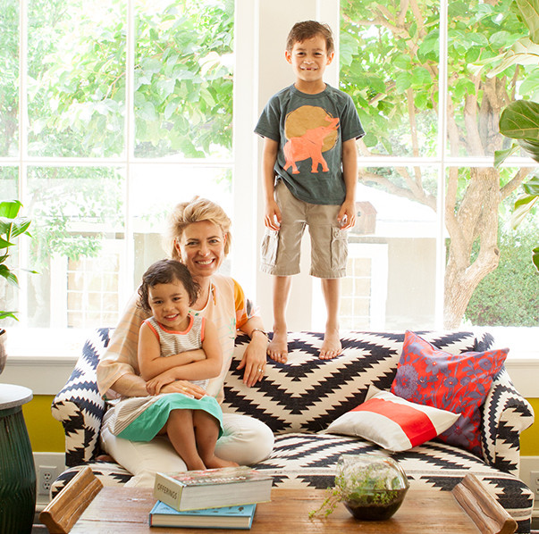 Meyer poses in the living room with her children: Clement, 6, and Georgia, 4.