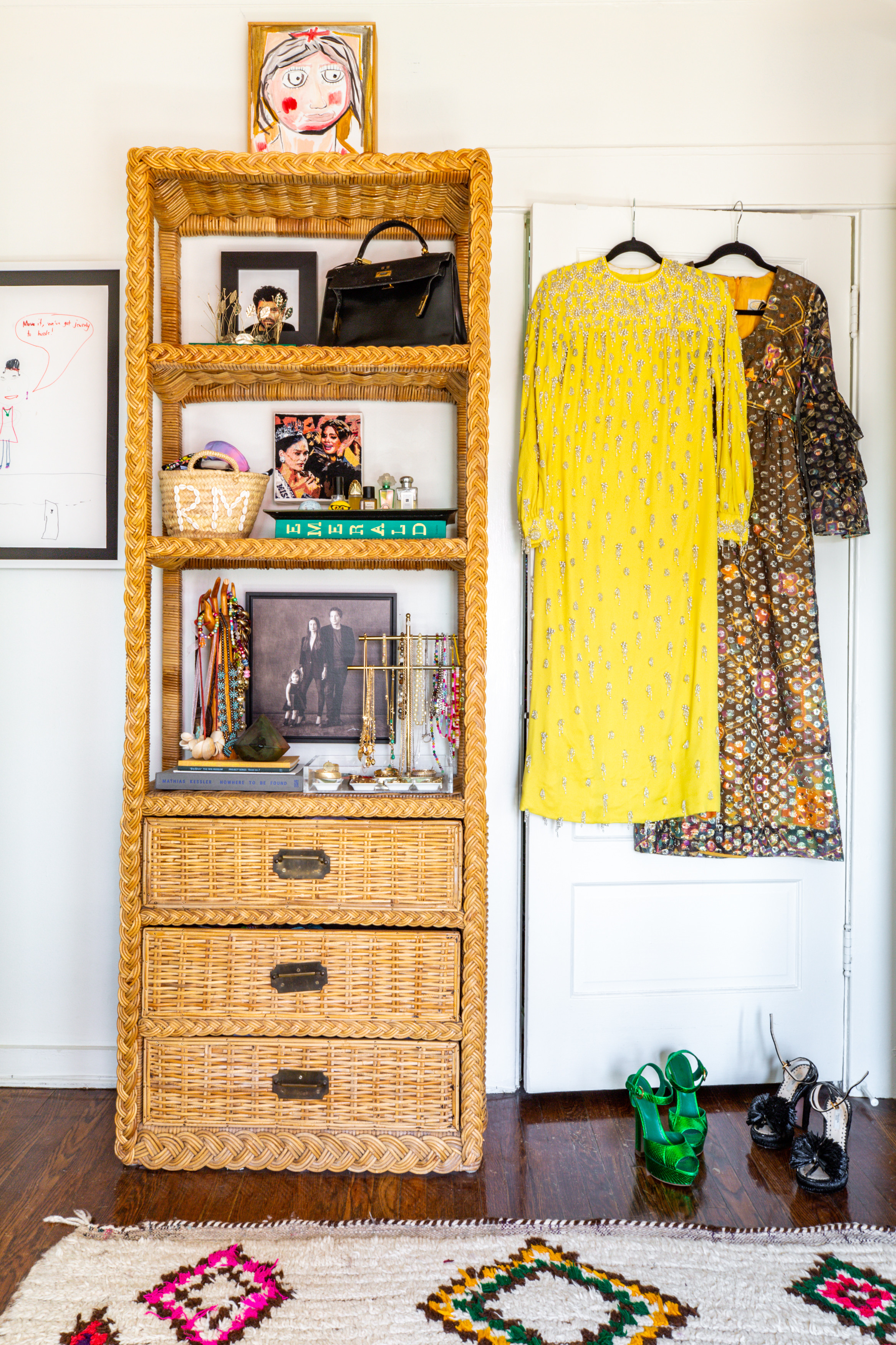 The home's closet is just as fashionable as the clothes that are stored here. Vintage Bookshelf | Vintage Moroccan Rug |Robert Gunderman Painting |Kim PterodactylEmbroidery |Kelly Lamb Sculpture.