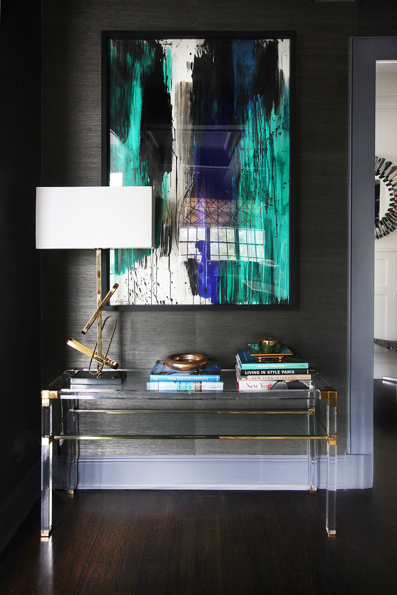 An Abstract Painting Glows Against A Grasscloth Wall Covering