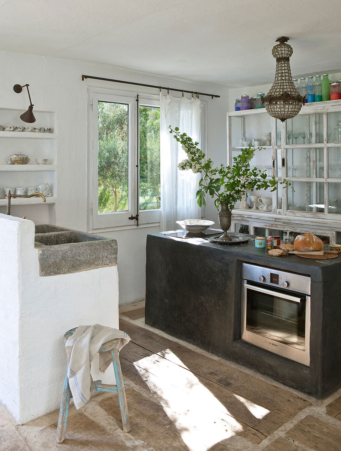 Modern conveniences and rustic concrete forms come together in the kitchen.