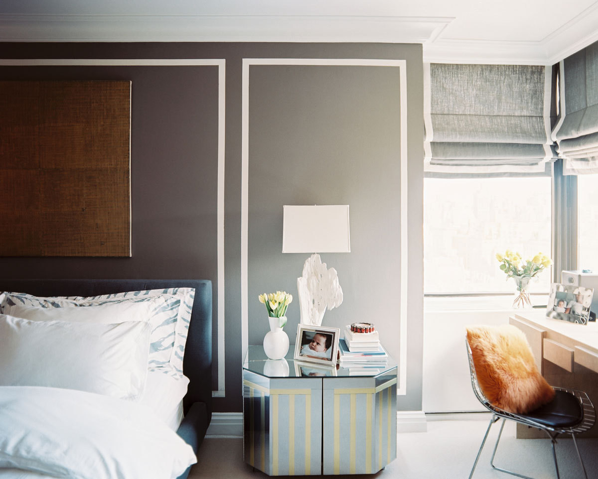The Garcias' bedroom lacked architectural distinction, so they painted faux molding on the walls. The geometricl ines establish a low-cost design element that recurs in the window shades and the side table, providing a unifying, decidedly modern motif.