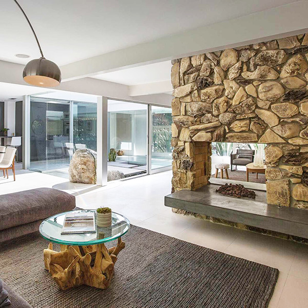 25 Celebrity Fireplaces We Want To Curl Up By This Winter