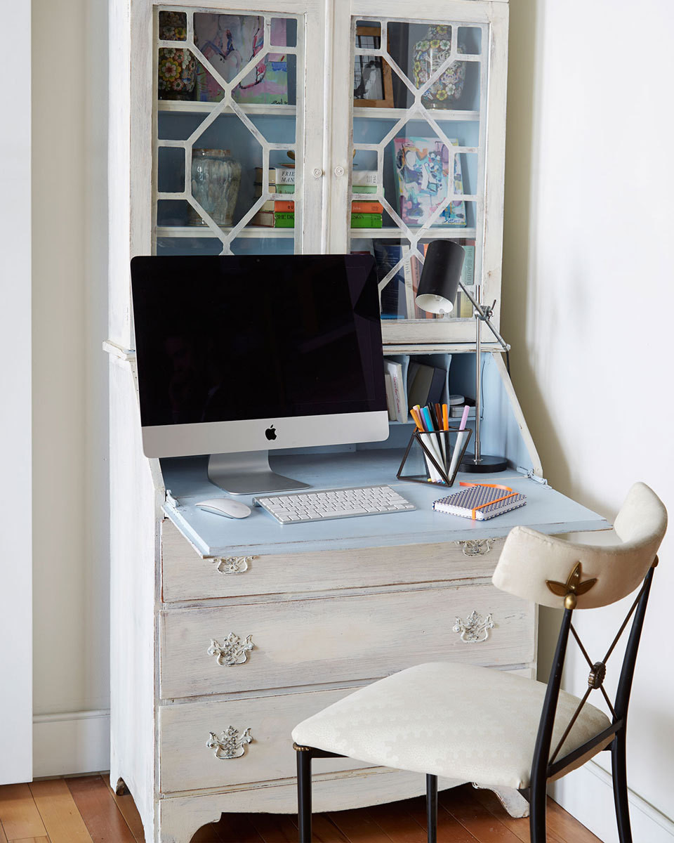 A vintage secretary serves as Hunter's home office.