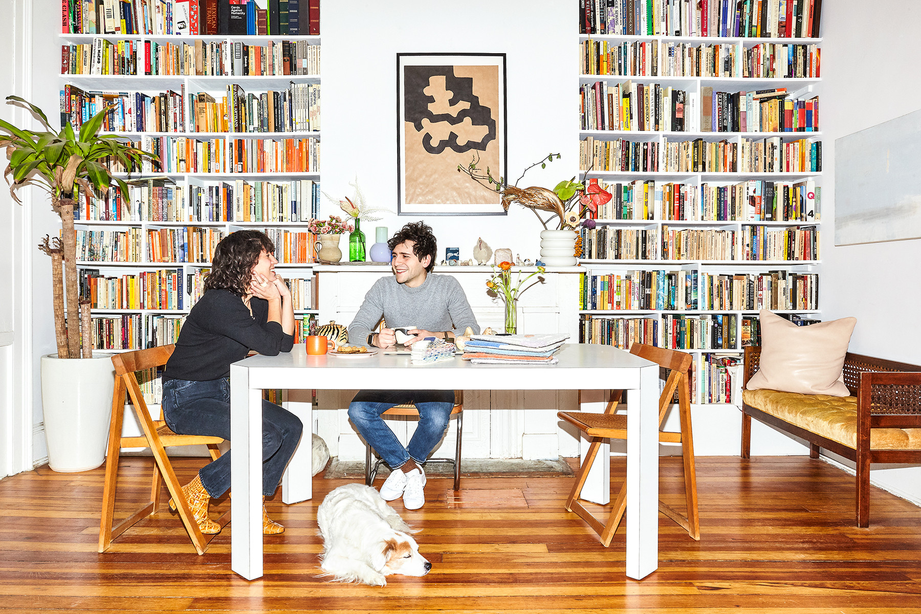 Pheobe Sung and Peter Bruer sit around their vintage formica table on Breuer and Wynne City Works chairs.