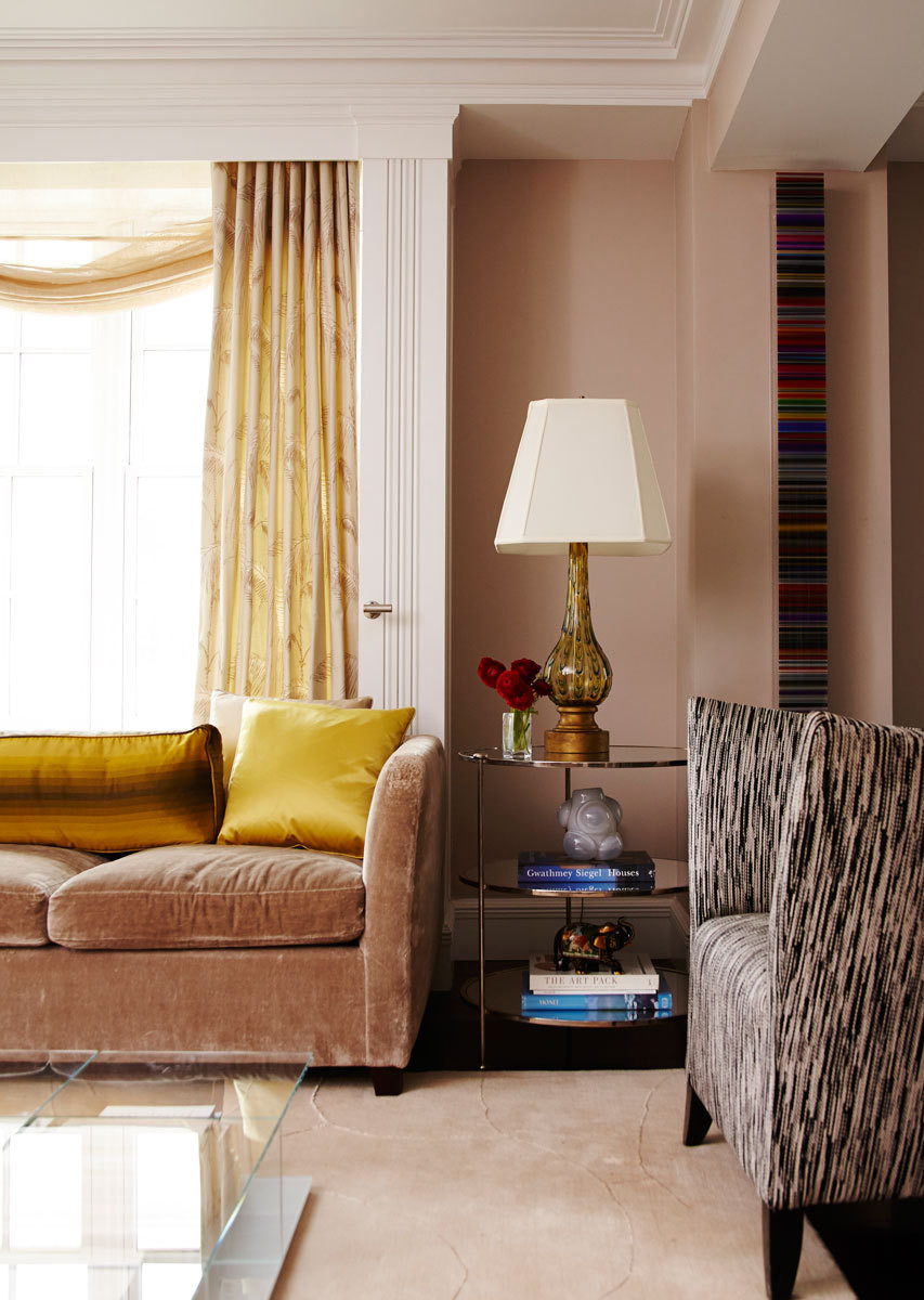 Button chairs in the living room are covered in Missoni fabric. The Andrew Martin sofas feature a Rose Tarlow silk velvet.