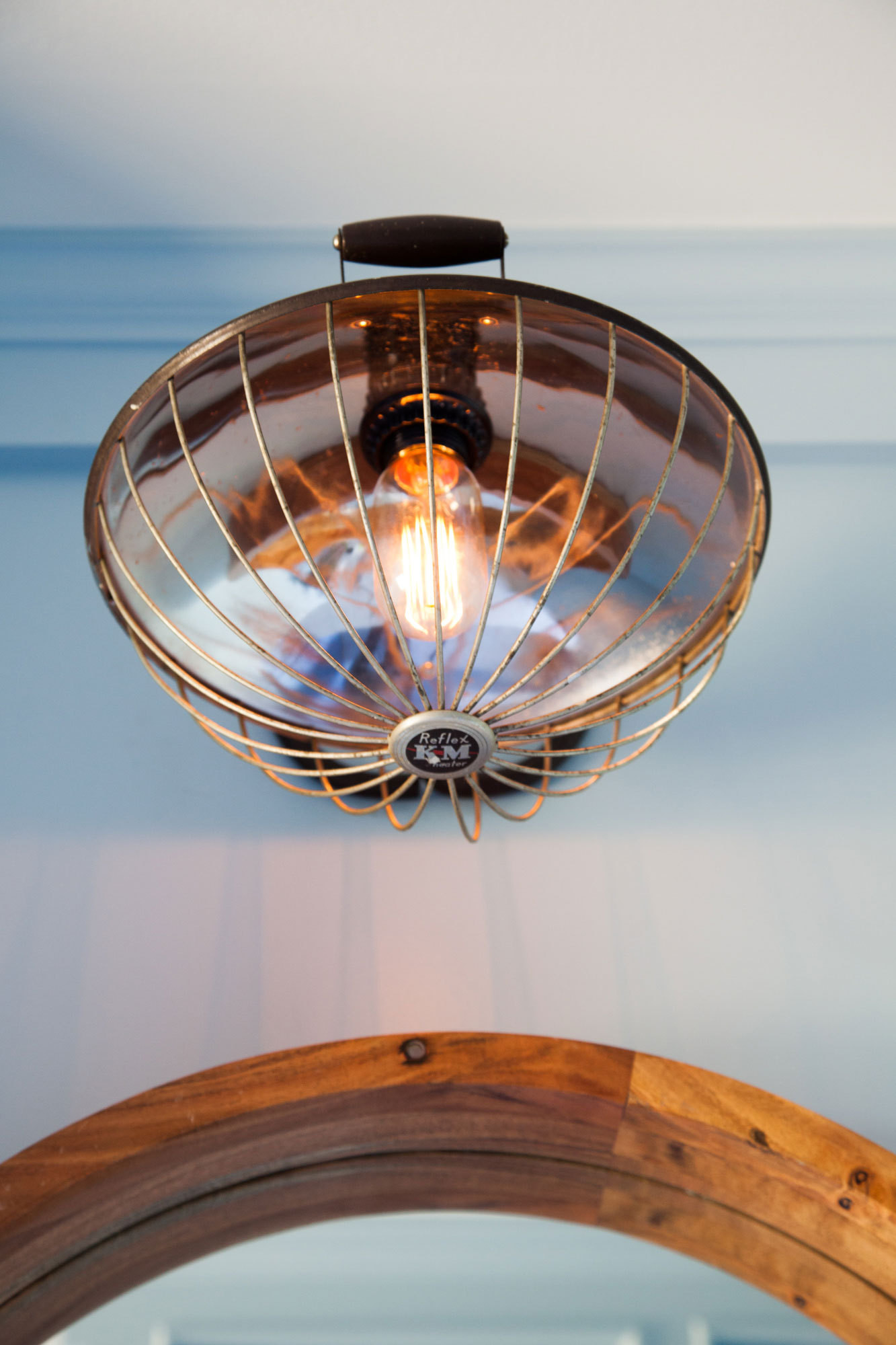 An antique fixture from Old Portland Hardware & Architectural adds an unexpectedly industrial note.