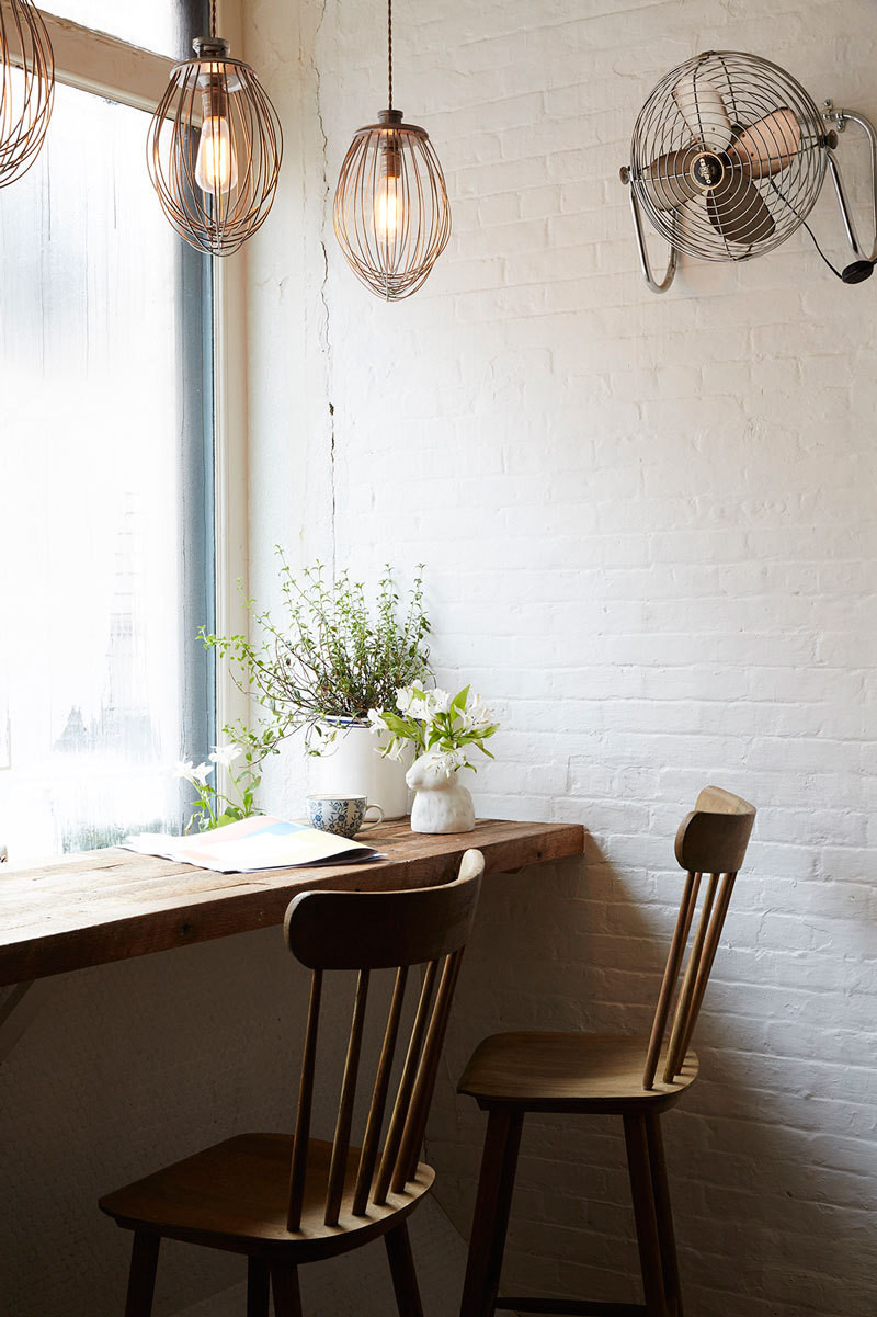 A vintage fan and mixers turned pendant lights help set the mood.