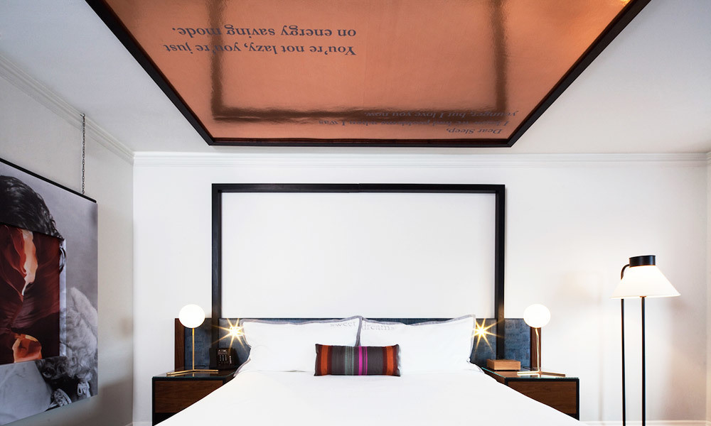 "In one of the guest suites, the copper Mylar panel above the bed is inscribed with, ""You're not lazy, you're just on energy saving mode."" Such cheeky quotes can be found in different iterations in each of the suites."