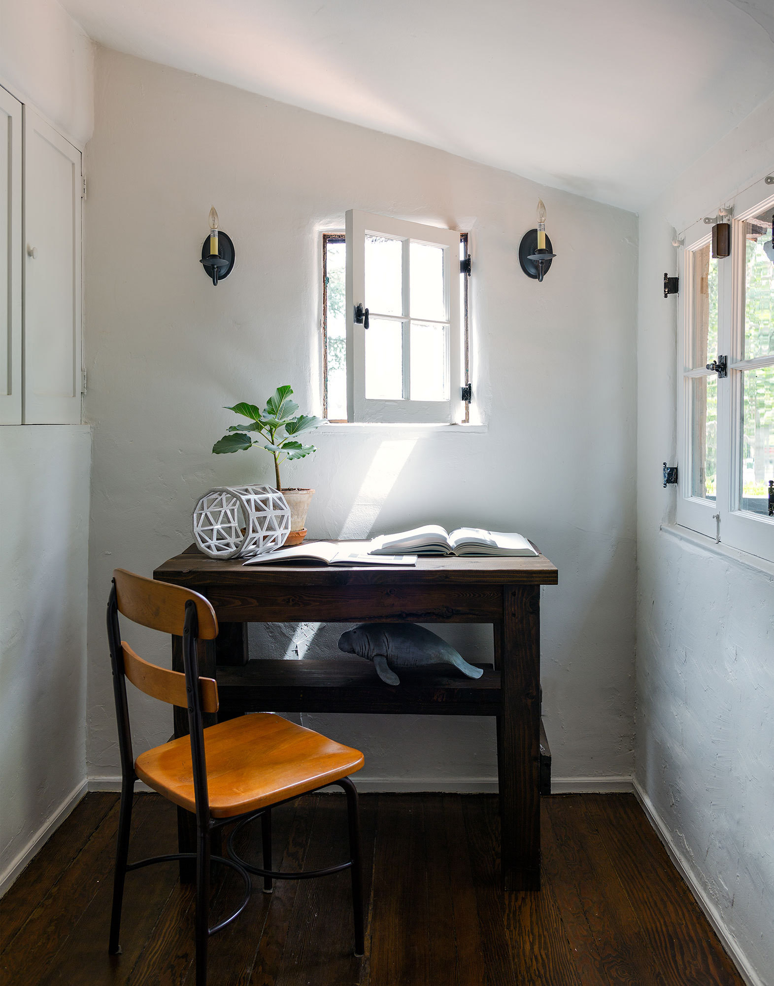 A cozy alcove serves as an impromptu workspace.