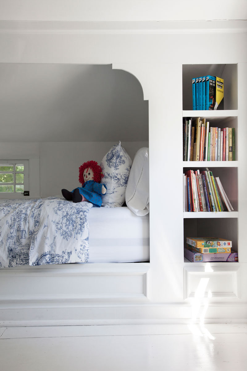 Buday designed cubbies for the kids' beds to maximize the low, sloping space.