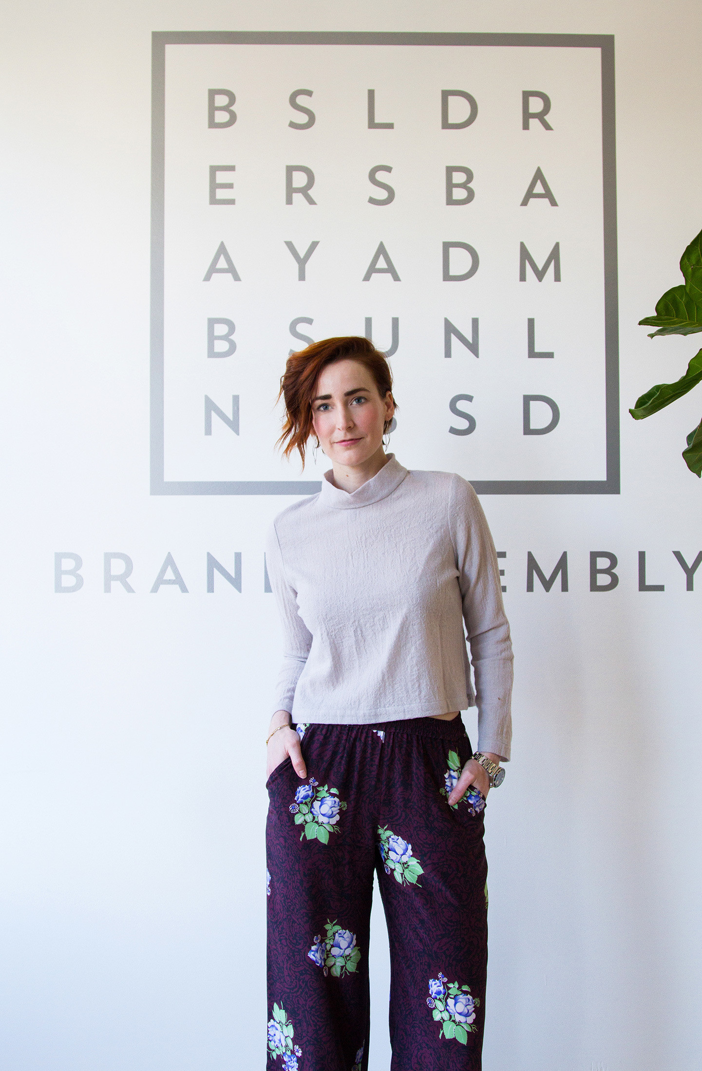 Brand Assembly's founder Hillary France at the entrance to Brand Assembly Square in New York. The fashion purveyor is stylishly clad in pants from Svilu and top from Silvae.