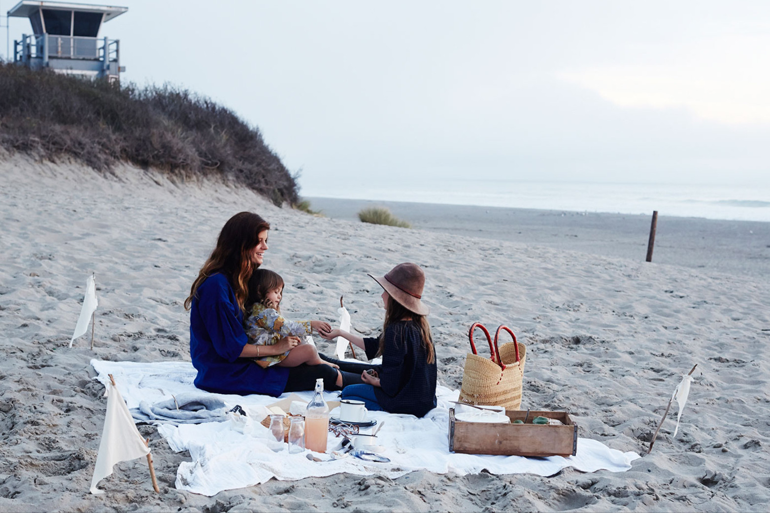Kendra Smoot with her daughters, Imogen and Stella, on Stinson Beach in Marin County, California.