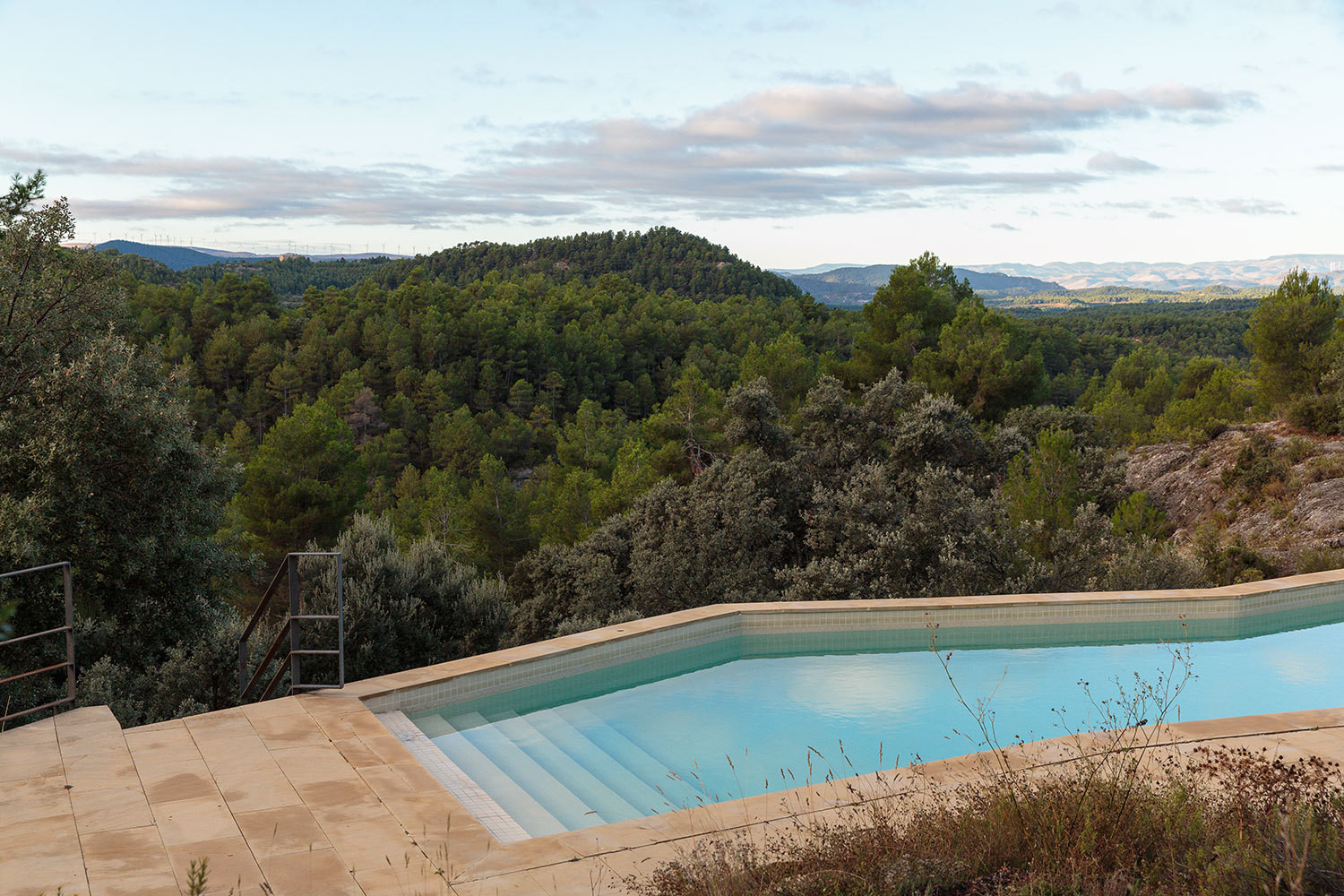 The hotel's pool, which overlooks ancient olive, pine, and almond trees.