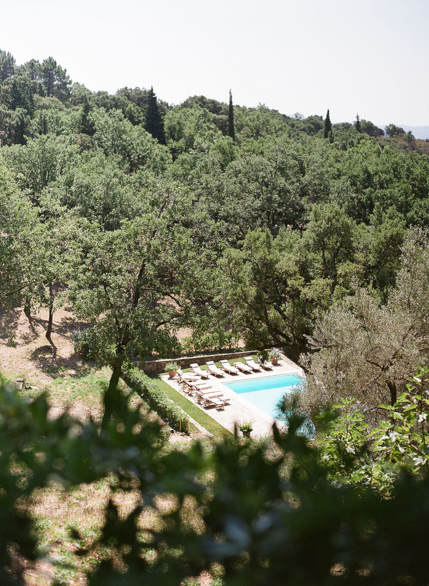 The rugged property is dotted with climbing roses, hydrangea, and olive trees.