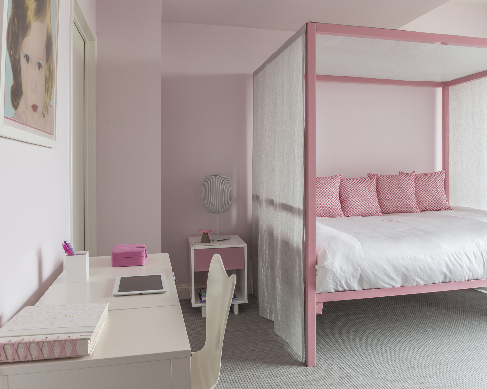 Daughter Olivia's room is a girly haven in shades of pink.