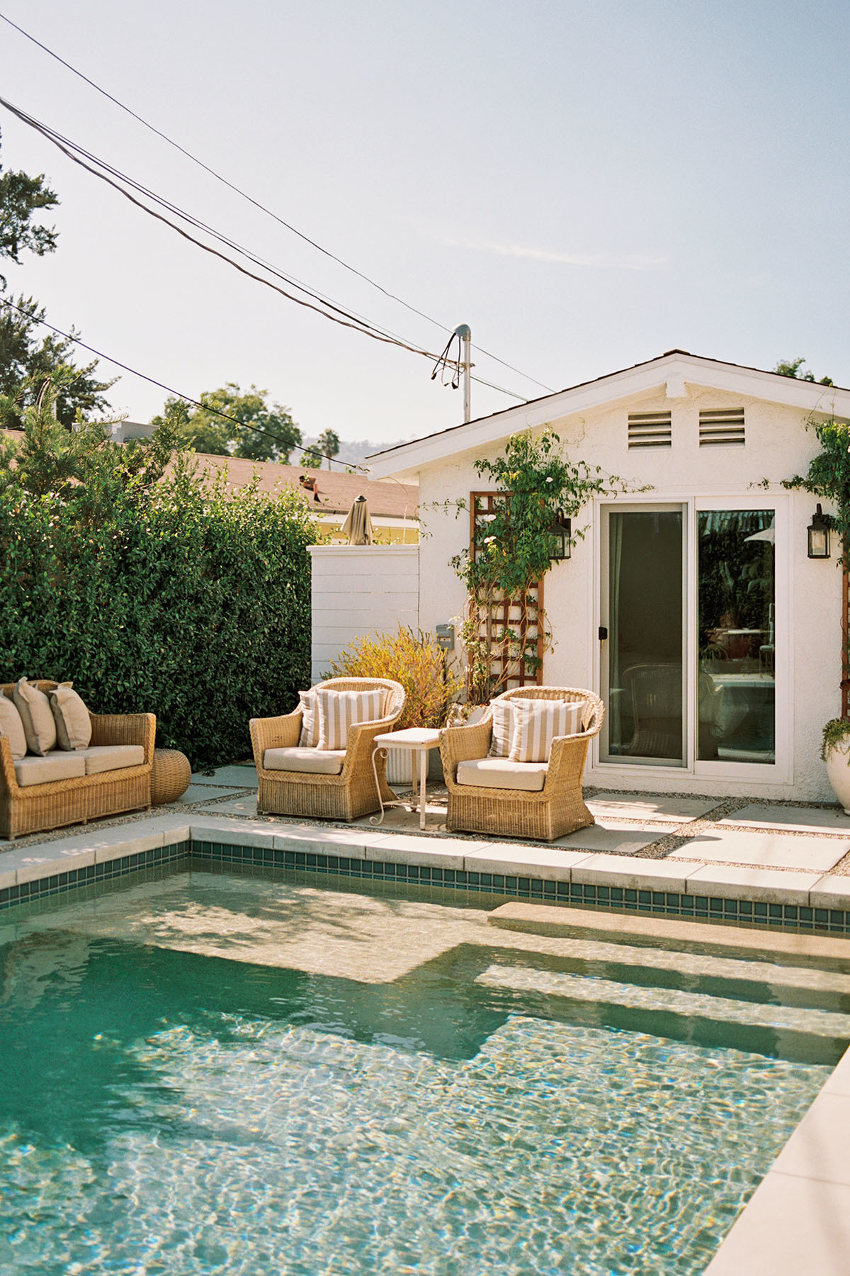 Poolside, Madison opts for vintage outdoor furniture and throw pillows by Outdoor Supply Hardware and Luxury Fabrics L.A.