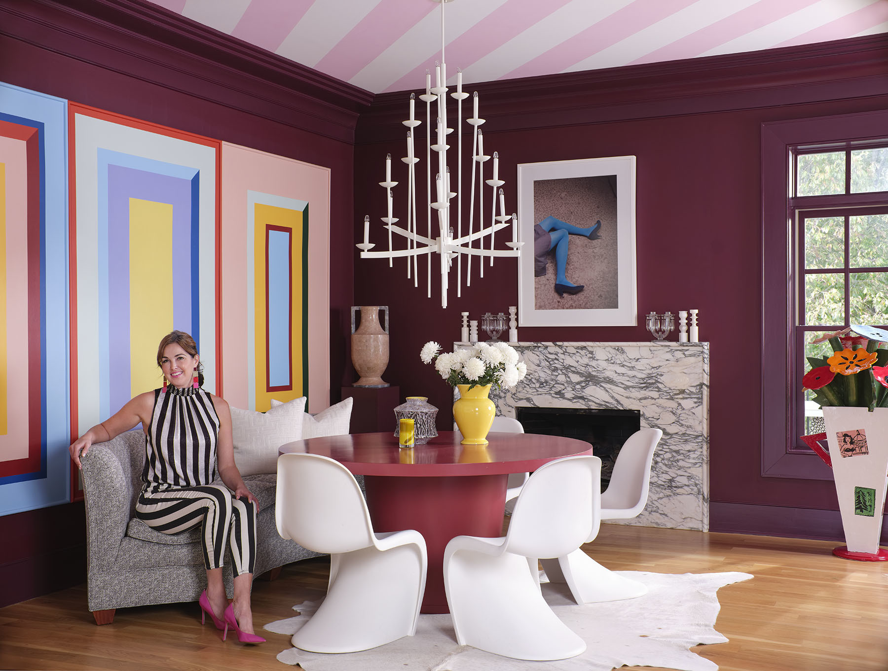 The potential for creative exploration is limitless in Blehm's dining room where she mixes color, pattern, shape, and texture with effortless ease. Crate & Barrel Dining Table | Panton Chairs | Vintage Love Seat | Angela Chrusciaki Blehm Artwork | Gillian Bryce Floor Vase | Vintage Floor Hide | Vintage Chandelier