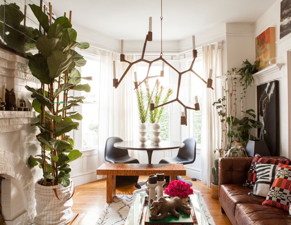 An unusual assemblage of plantings, artworks, and personal possessions populate Christiana Coop's living room, where intentionally white walls allow the objets to shine.
