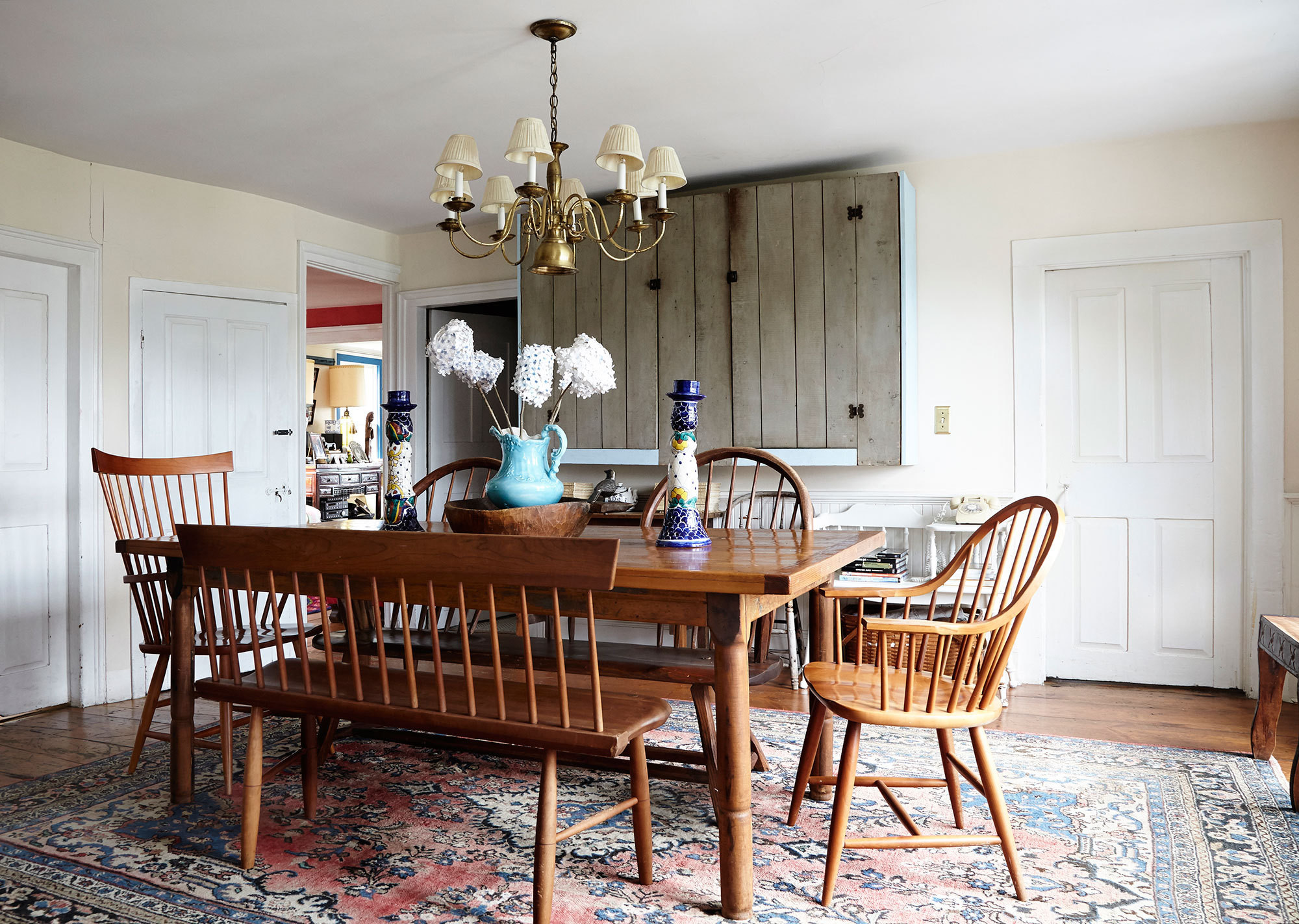 The familyu0027s dining room features Shaker style seating