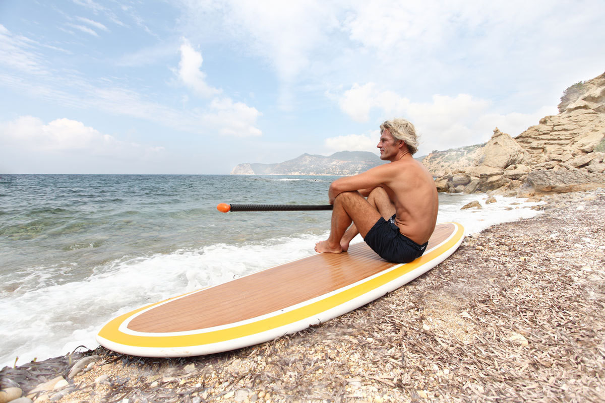 Bobby Dekeyser with his paddleboard on a recent trip to the island of Ibiza.