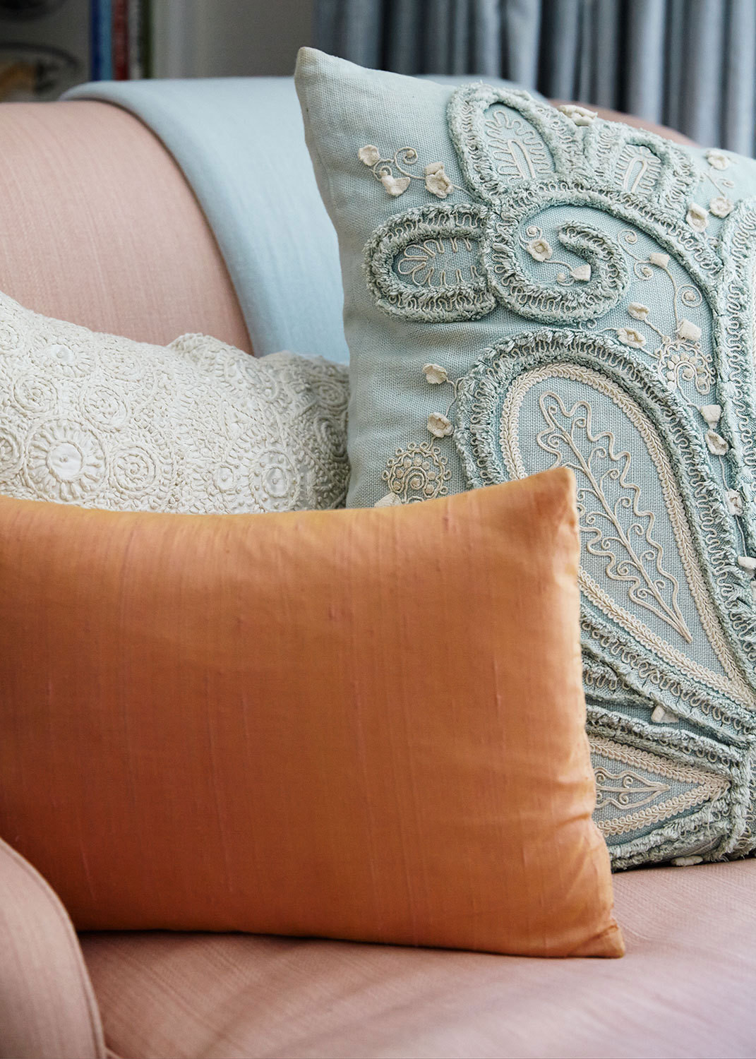 Decorative pillows on the master bedroom's chaise longue.