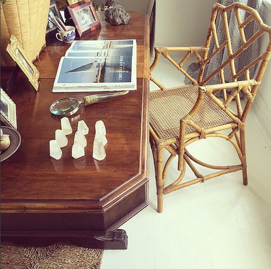 A desk vignette featuring a thrifted bamboo chair.