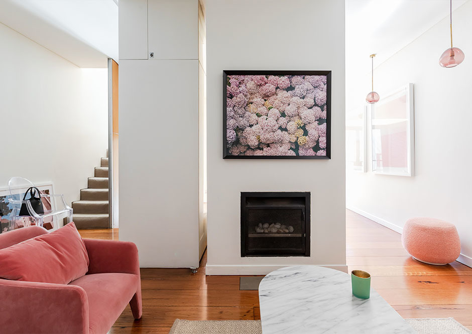 """I love the photograph above the fireplace, of the hydrangeas by Derek Henderson — my Mom gave it to me for my 30th birthday,"" explains Tran. Cult Furniture Ghost Chair 
