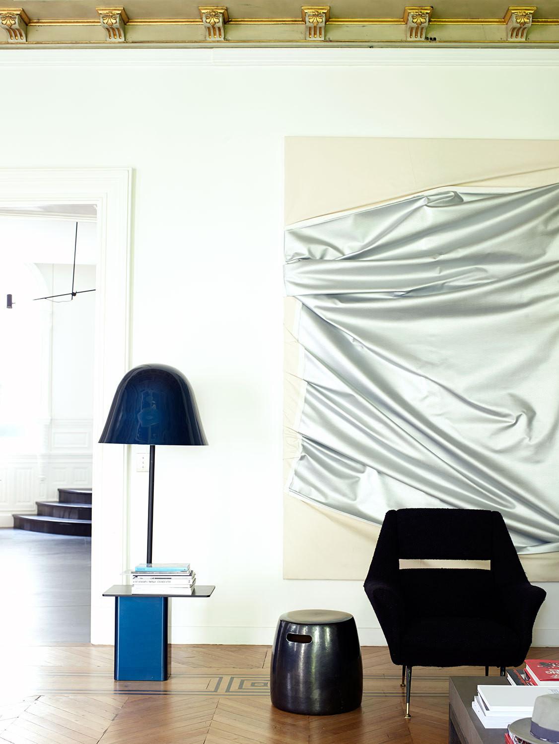 Steven Parrino's <em>Death in America #2 </em>(2005) is displayed near the Bells floor lamp by Ronan & Erwan Bouroullec.