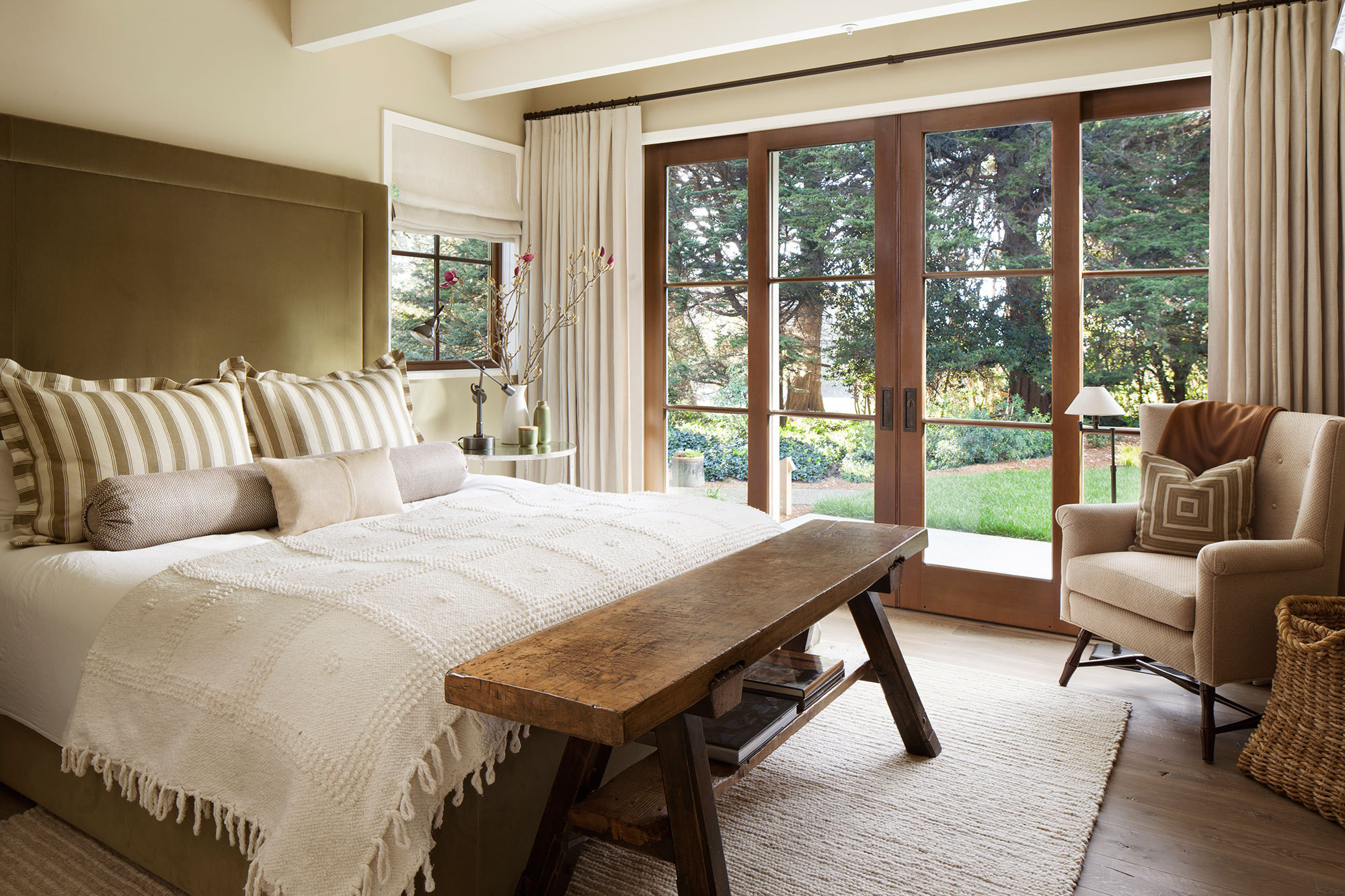 The master bedroom maintains the house's neutral palette thanks to Farrow & Ball's Fawn No. 10 on the walls.