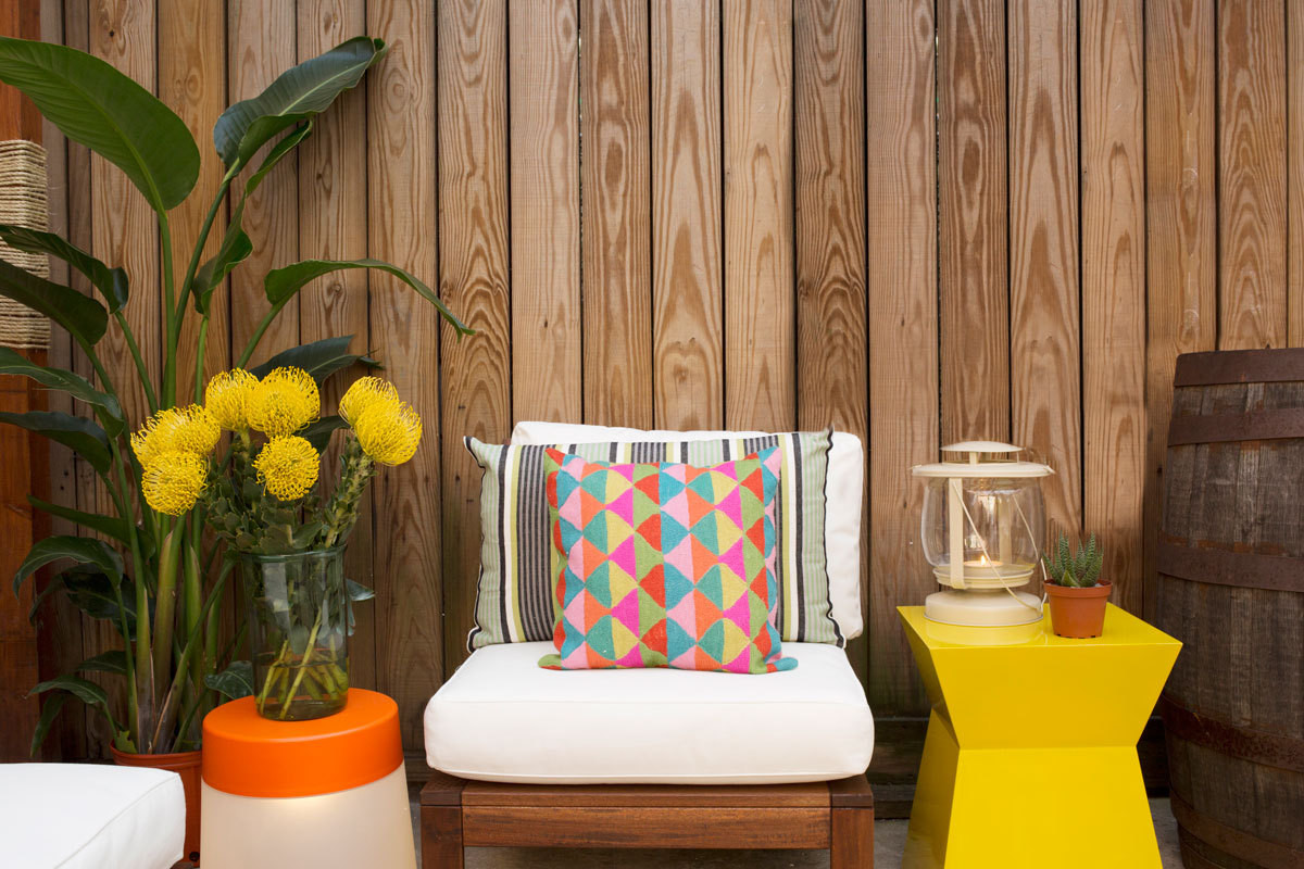 Yellow pincushion protea are displayed on IKEA's PS 2014 LED Stool Lampin our backyard vignette. Written and produced by Kaylei McGaw. Prop styling by Martha Bernabe.