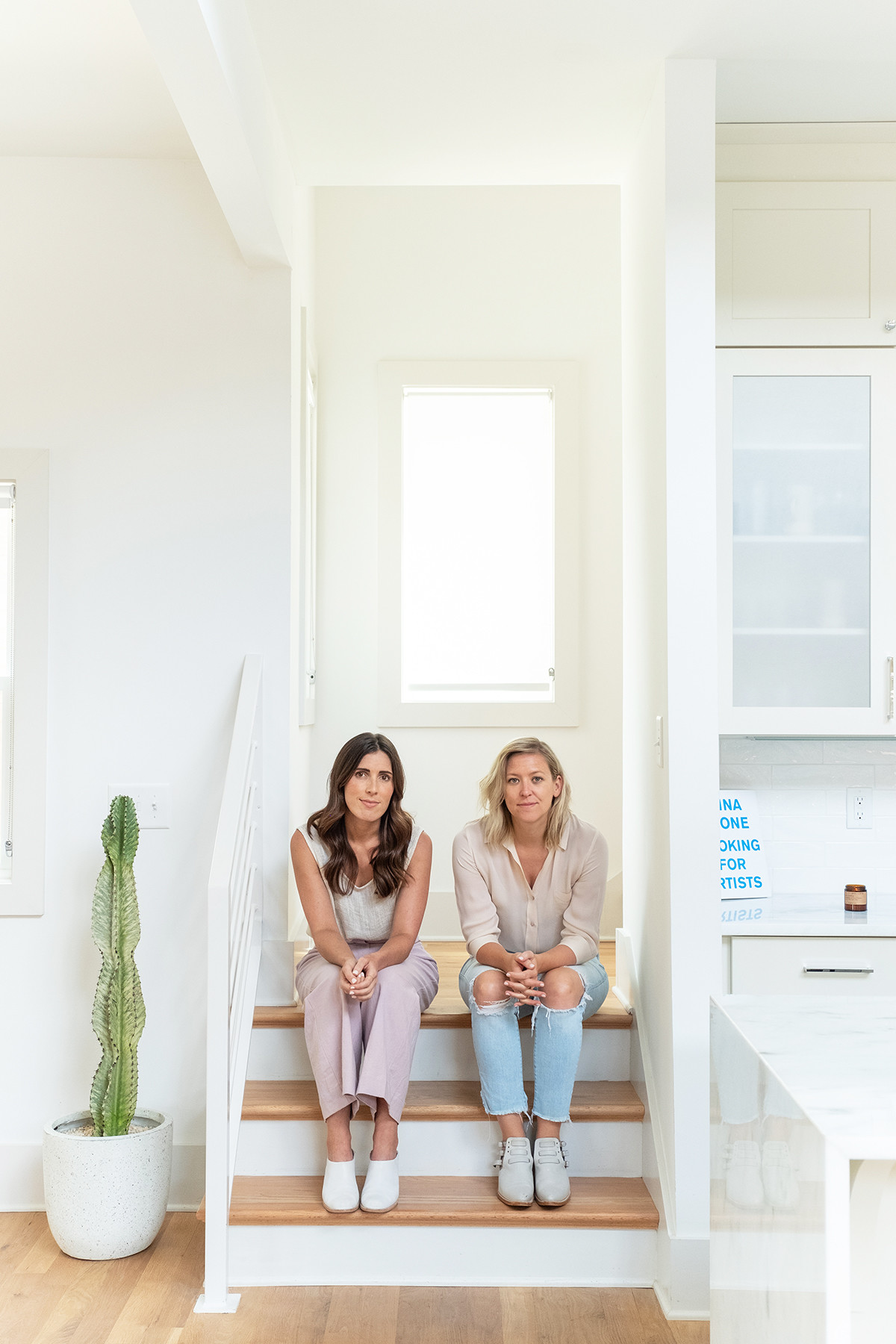Milkglass Creative co-founders Mary Hooper and Amy Stroup sit inside their studio.