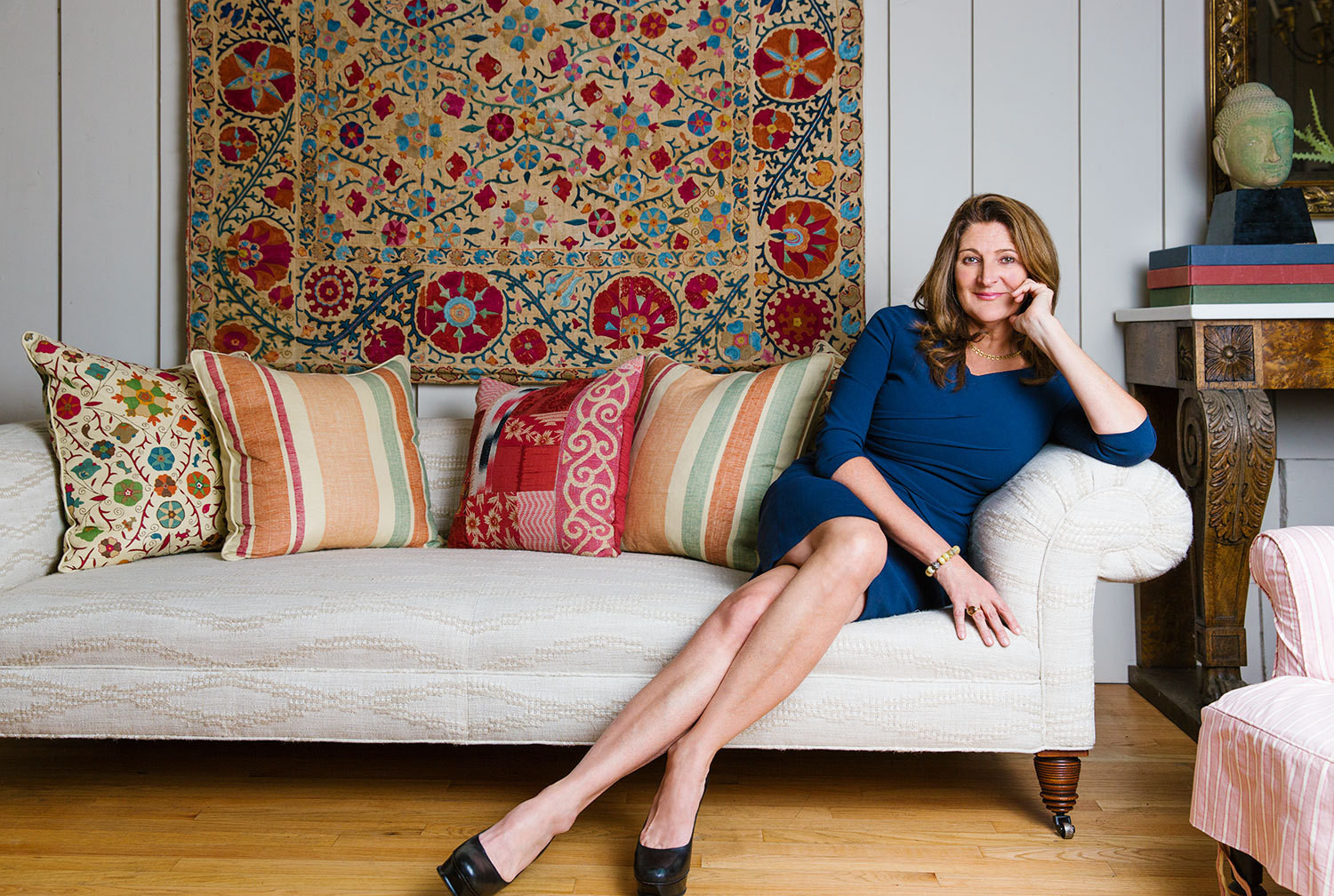 The designer, on a chesterfield sofa upholstered in one of her fabrics, in her Los Angeles studio.