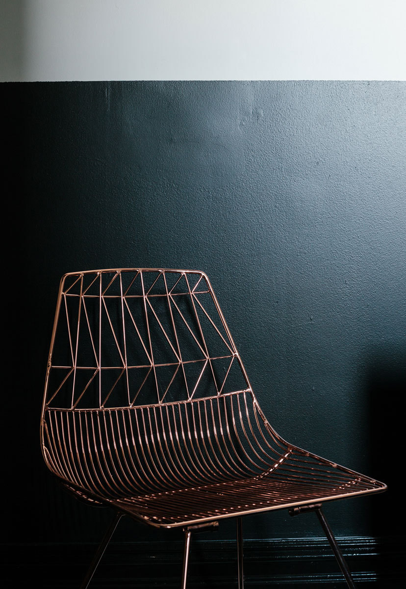 A copper Bend Goods chair in the guest room doubles as sculpture.