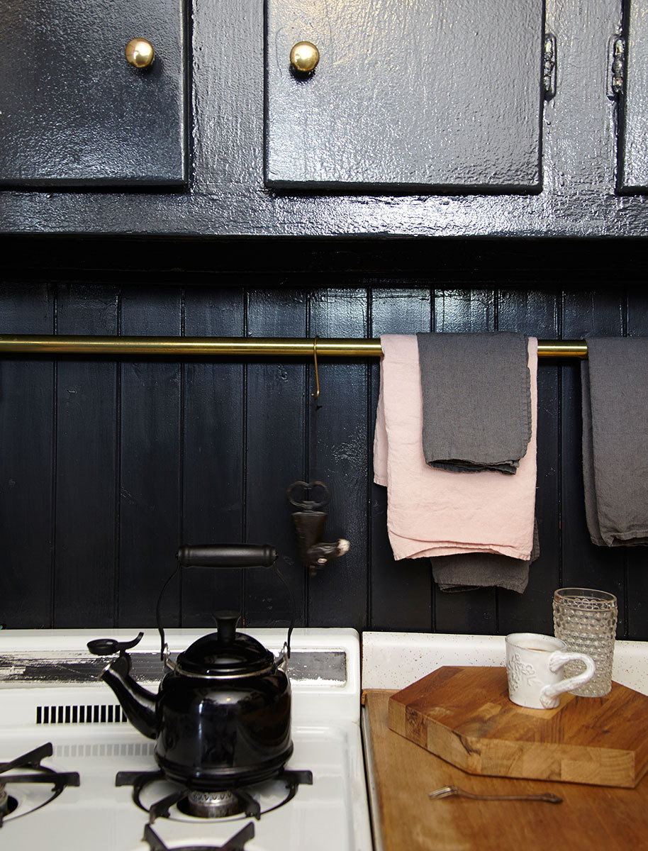 The kitchen is clad in Farrow & Ball's Off Black.