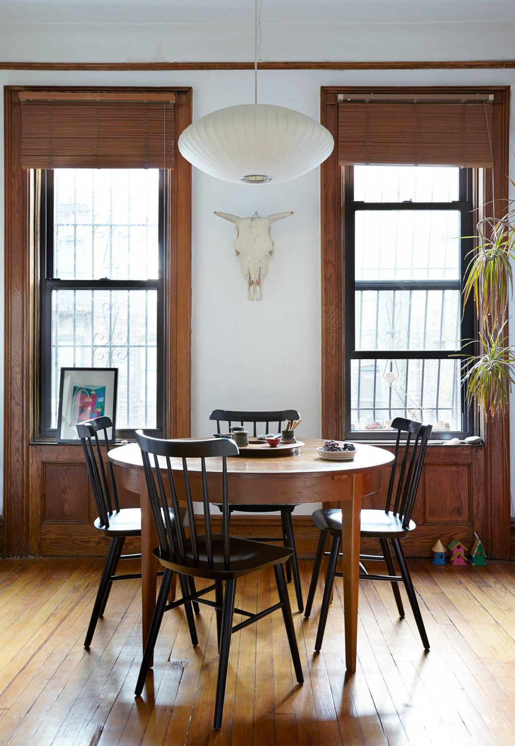 Veith Krienke's midcentury table is paired with chairs and a Nelson pendant from Design Within Reach.