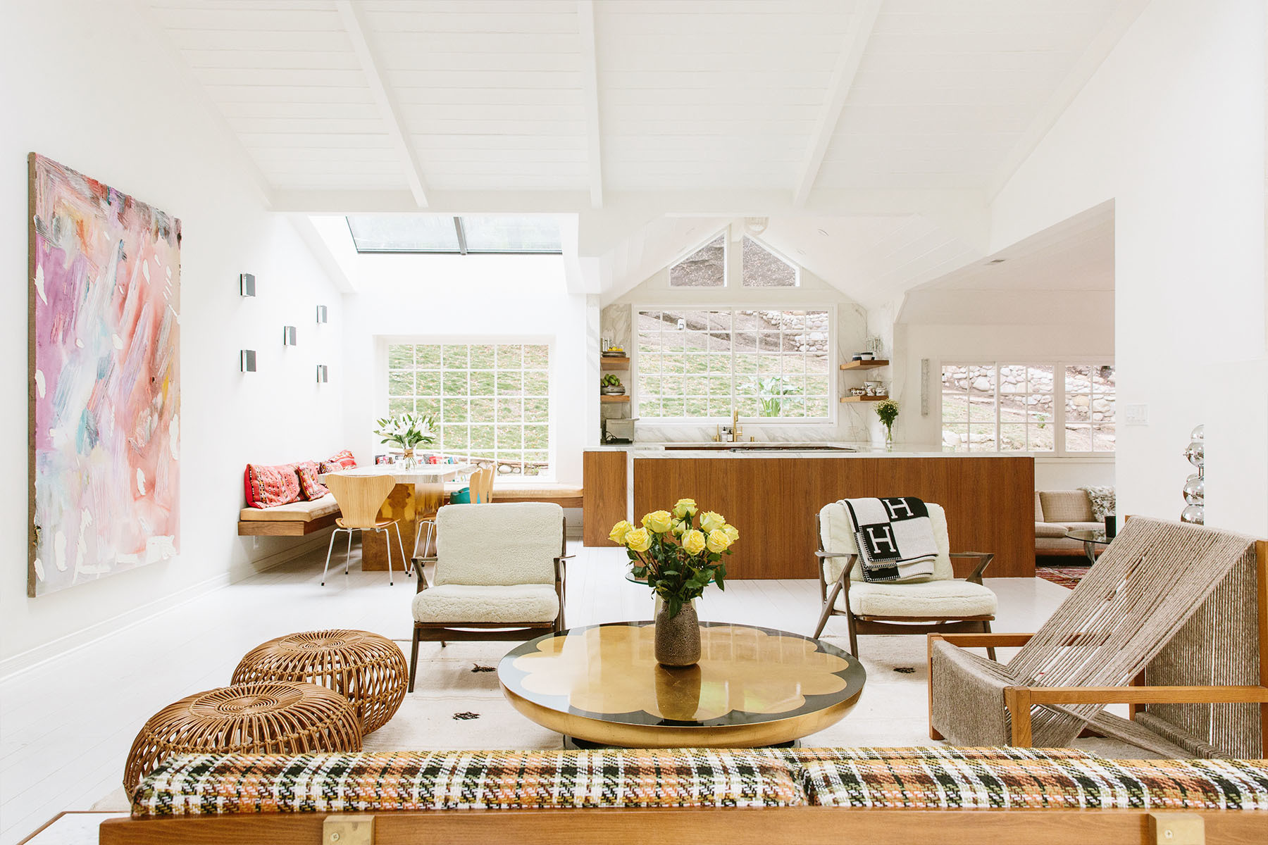 Shelley and Teddy Sanders broke down walls and cut out skylights to give their Beverly Hills home a dreamy sense of flow. Dashiell Manley Art | Vintage Furniture | Couples own Lighting | Lawrence of La Brea Rug.