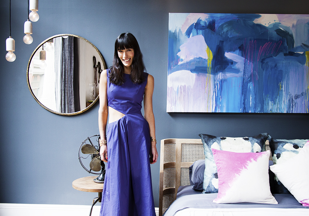 Calderone in her Pinterest-designed bedroom for CB2.