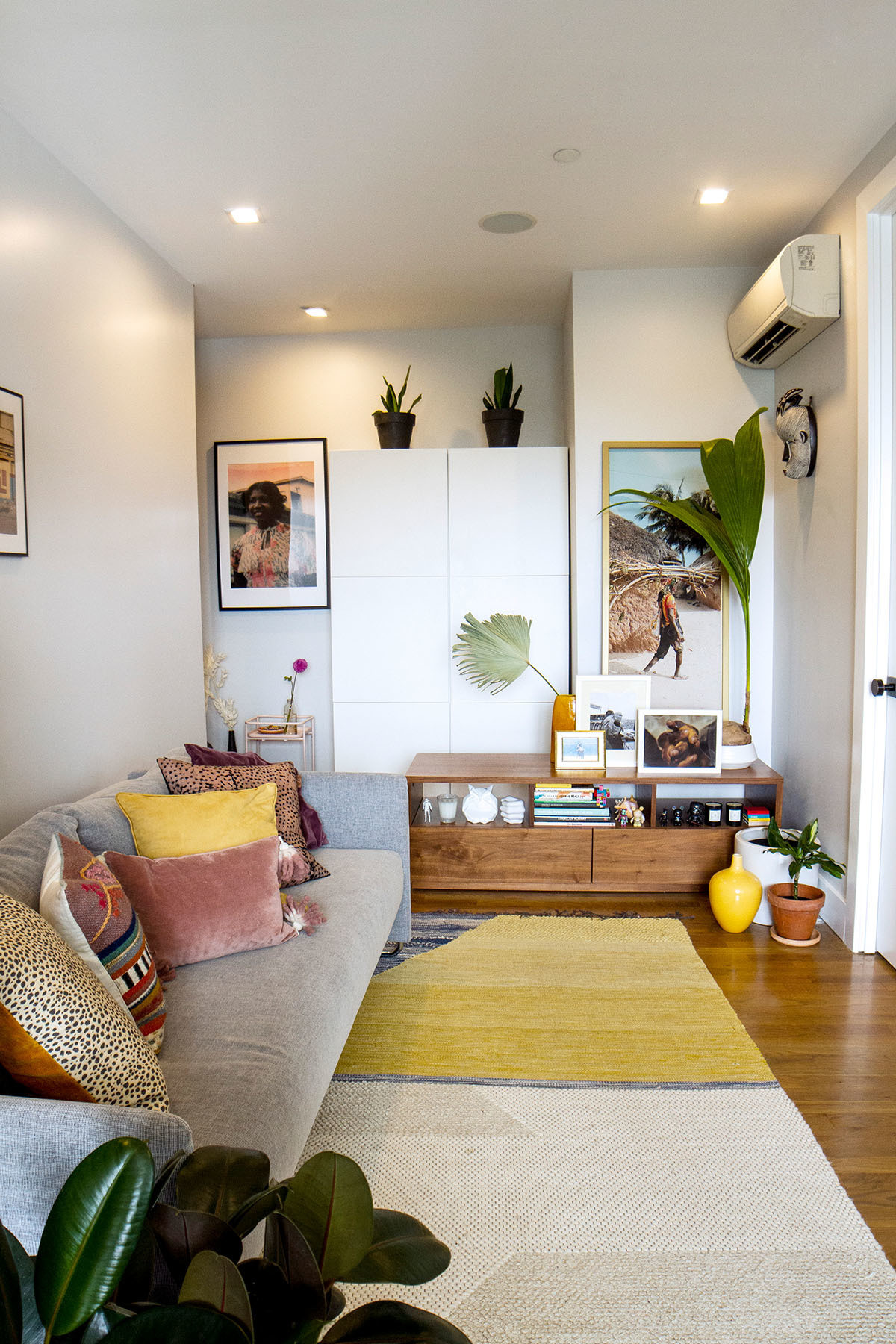 The designer duo outfit their tiny living space with aCB2 sofa,West Elm rug, and assortedIKEA finds.