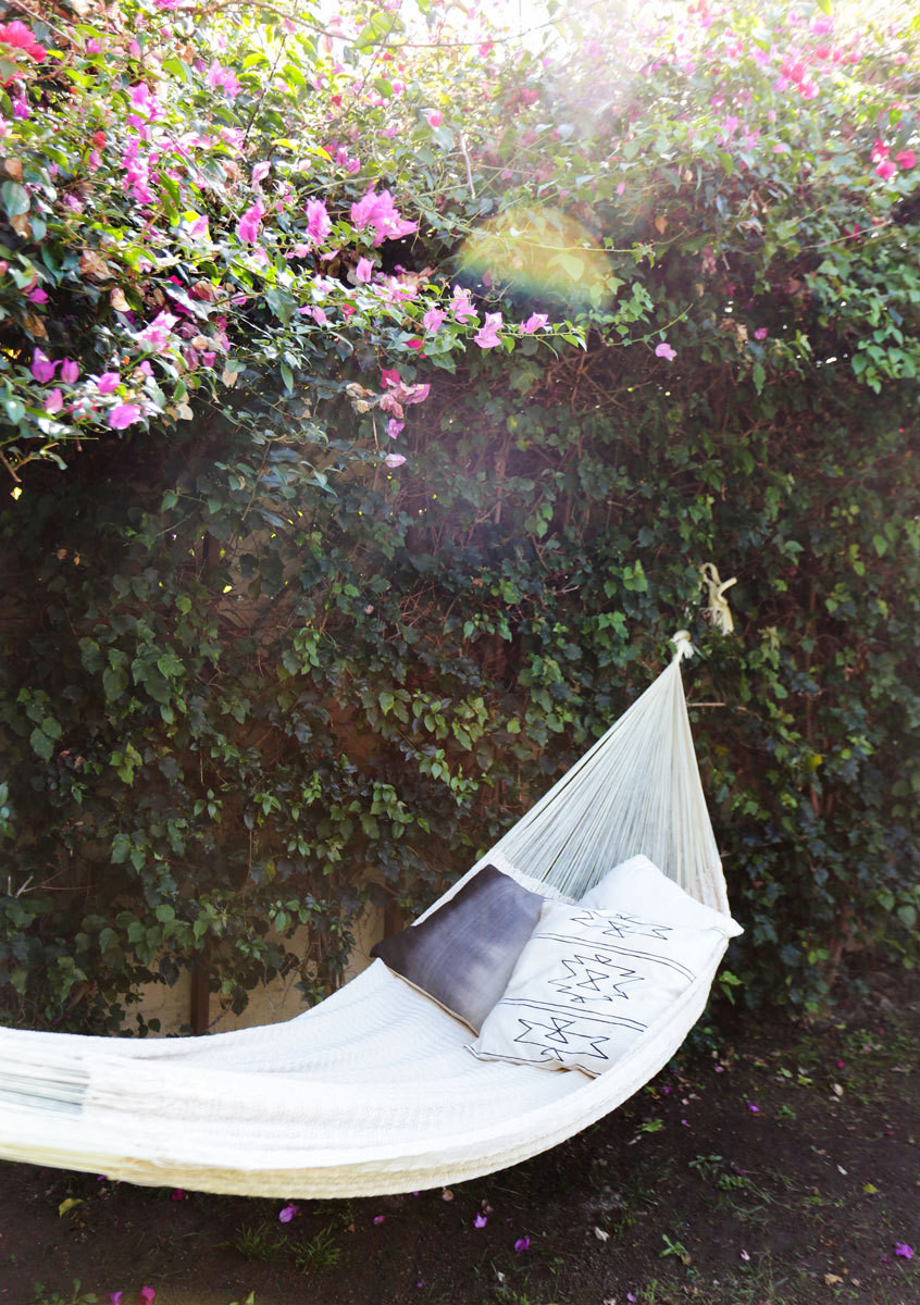 In Southern California, a simple hammock accented with boho throw pillows, is a backyard essential.