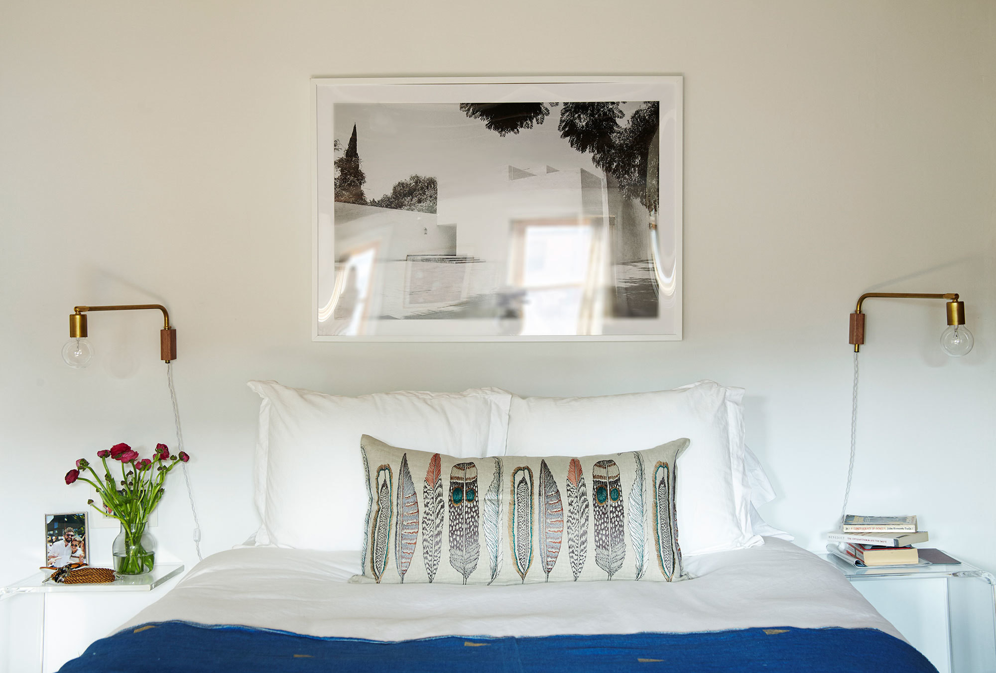 a jewelry designer s travel inspired home home tour lonny a simple plush white bed creates a relaxing oasis