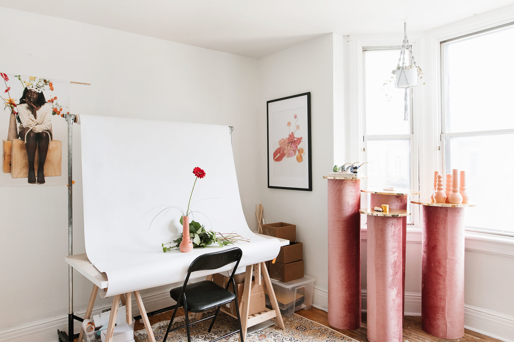 Dineen's studio space features a customized IKEA artist's easel, pink pedestals by Diana Vander Meulen, and Sackville & Co. prints by Duncan Foy.
