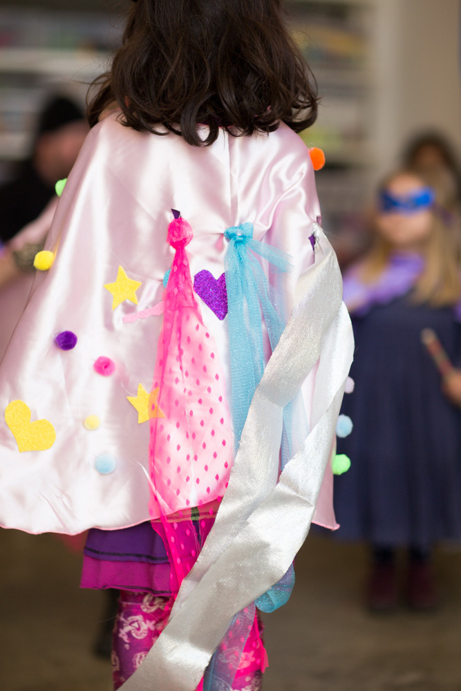 Curious Jane's decorate-your-own superhero capes were a huge hit with party guests.