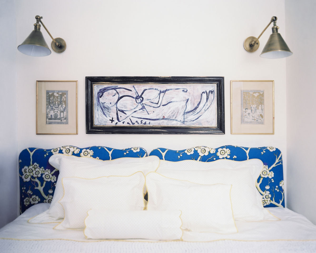 Burke turned her bedroom's limited wall space to her advantage. Lacking room for side tables, she installed swing-arm lamps that add an industrial-inspired counterpoint to her floral headboard and scalloped linens.