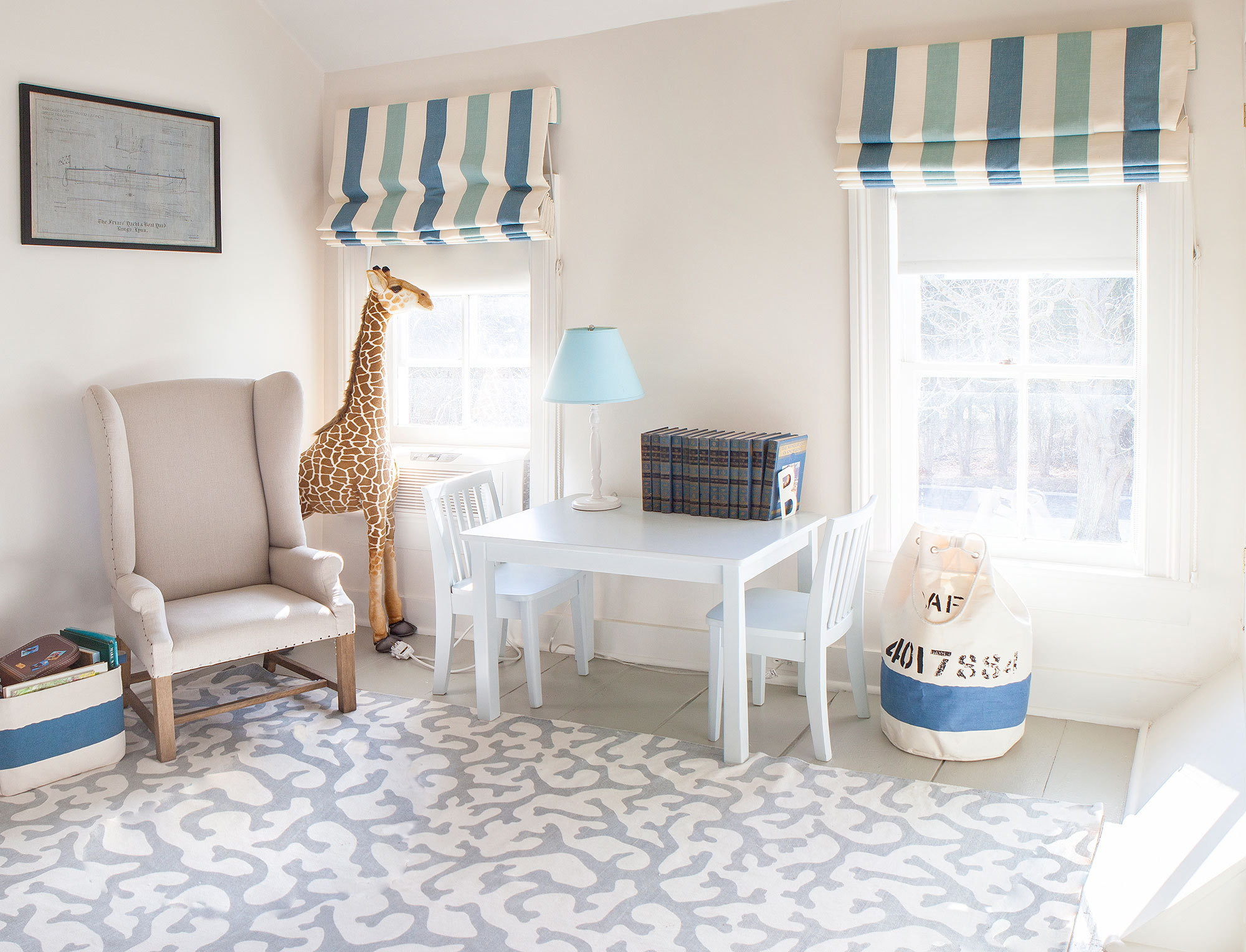 The nursery's gray and blue color scheme is both child-friendly and stylish.